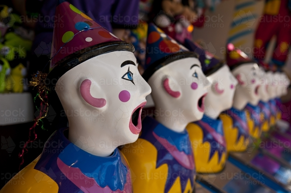 Row of clown heads, turning away - Australian Stock Image