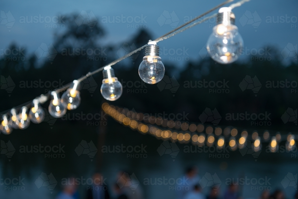 Row of party lights at dusk - Australian Stock Image