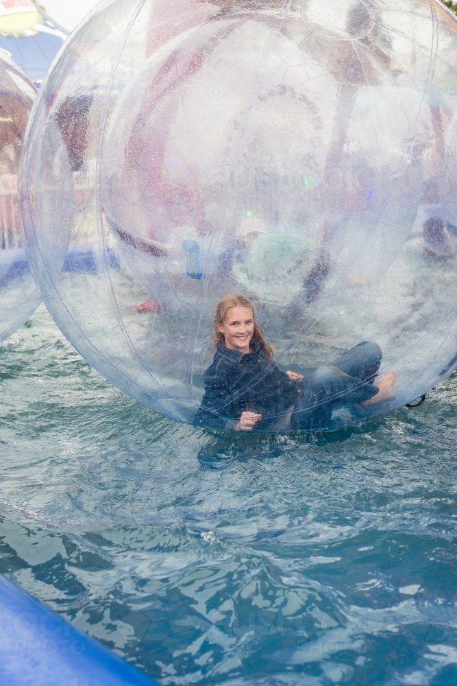 royal show, girl in large hamster water walking ball - Australian Stock Image