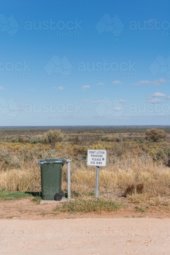 Rubbish bin and sign at roadstop - Australian Stock Image