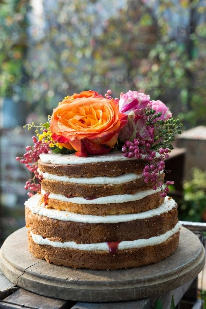 Rustic birthday cake with flowers - Australian Stock Image