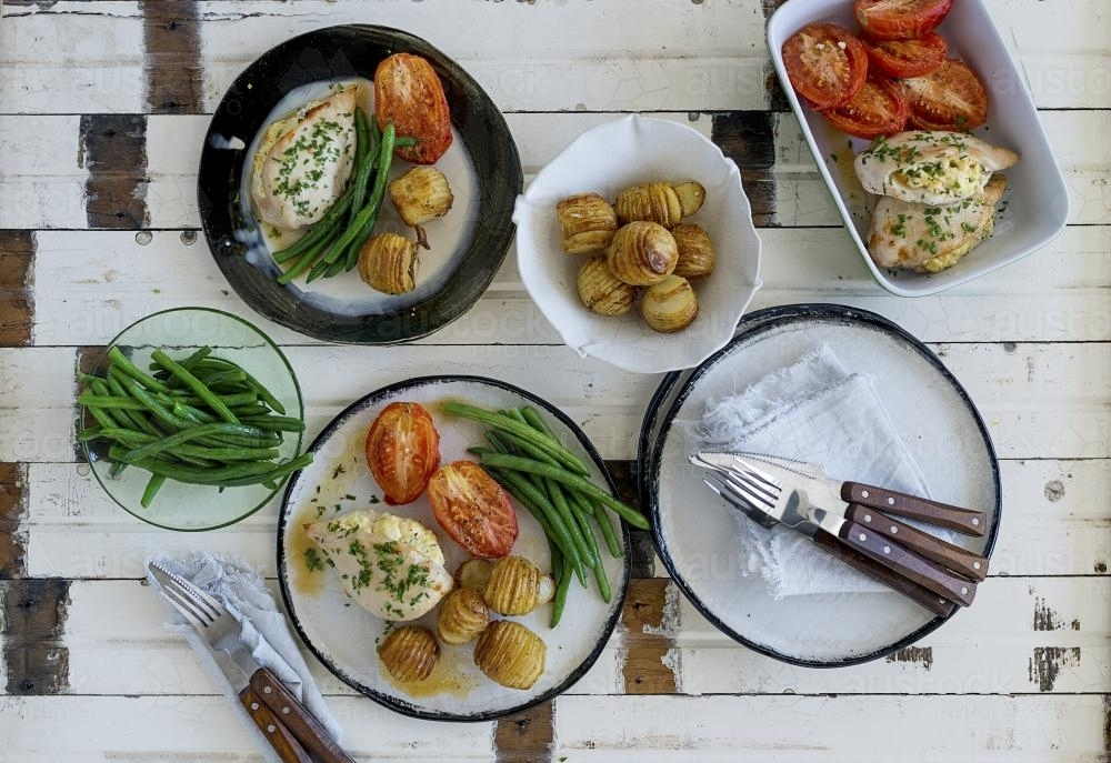 Rustic roasted chicken dish viewed from above - Australian Stock Image