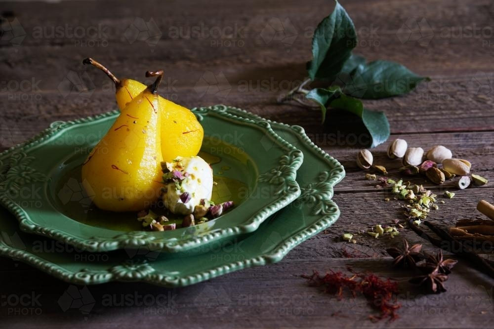 Saffron pears with marscapone and ingredients - Australian Stock Image