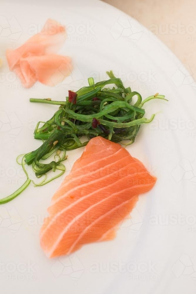 sashimi with Japanese seaweed salad and pickled ginger - Australian Stock Image