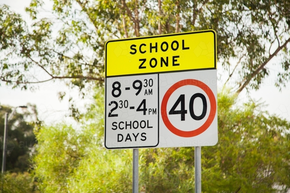 School zone with green bush and gum tree background - Australian Stock Image