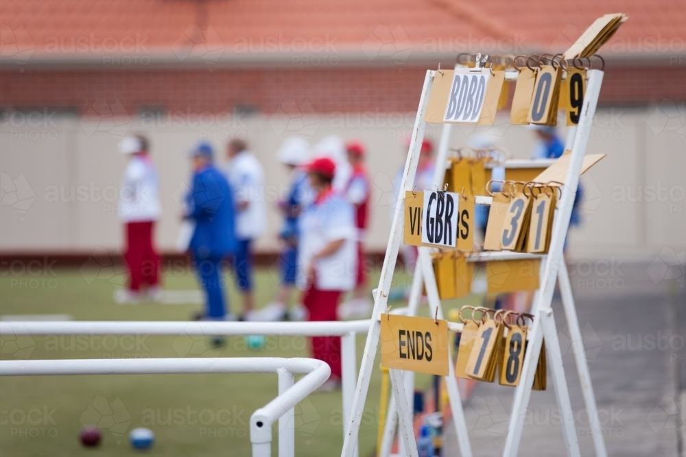 Scoreboard and bowlers at a lawn bowls club - Australian Stock Image