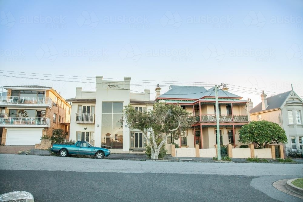 Seaside houses with a car parked out the front - Australian Stock Image