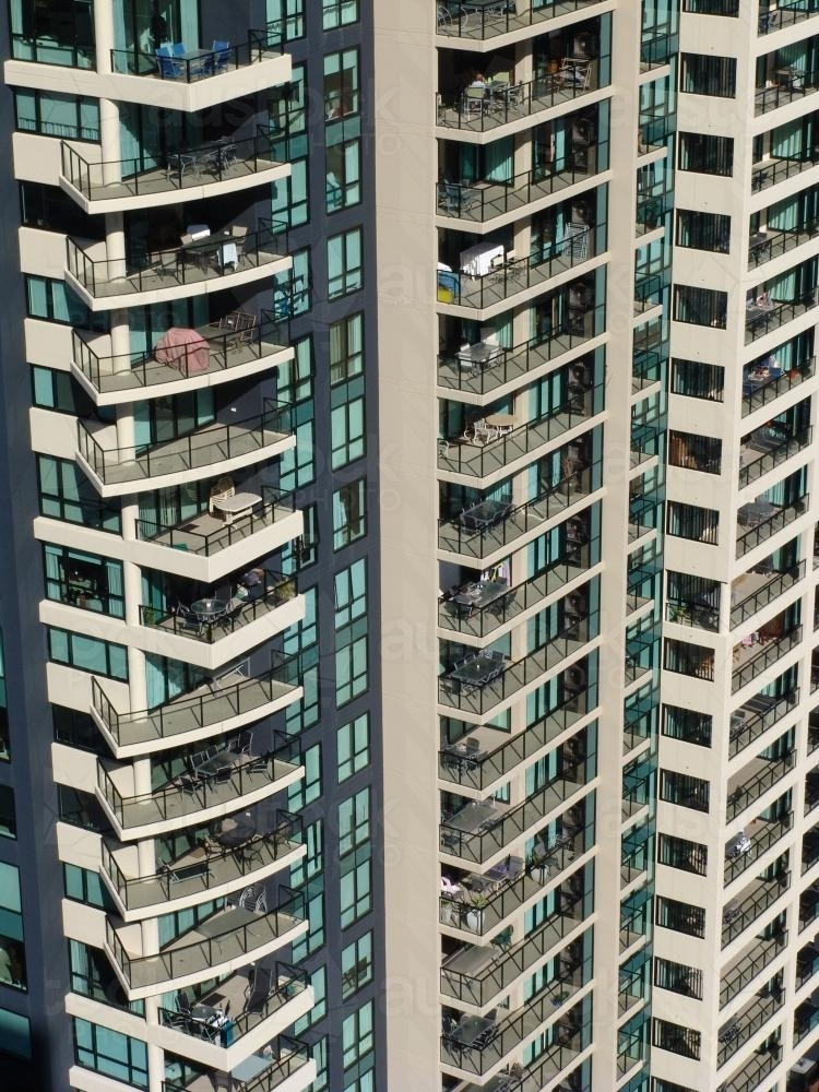 Section of a high rise building with window and balcony detail - Australian Stock Image