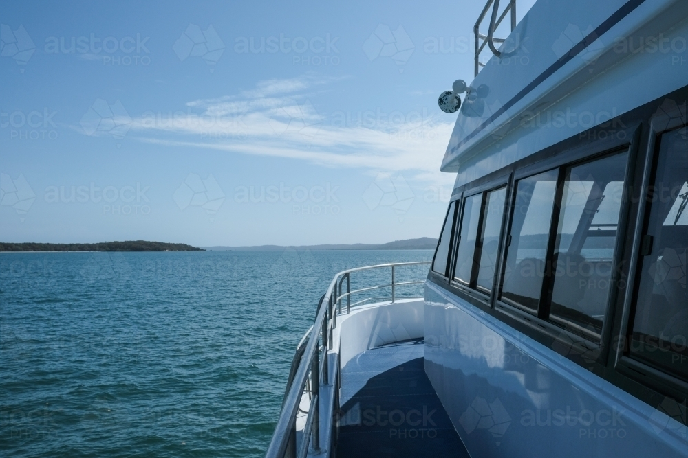 Side of ferry boat on water going to Dunwich - Australian Stock Image