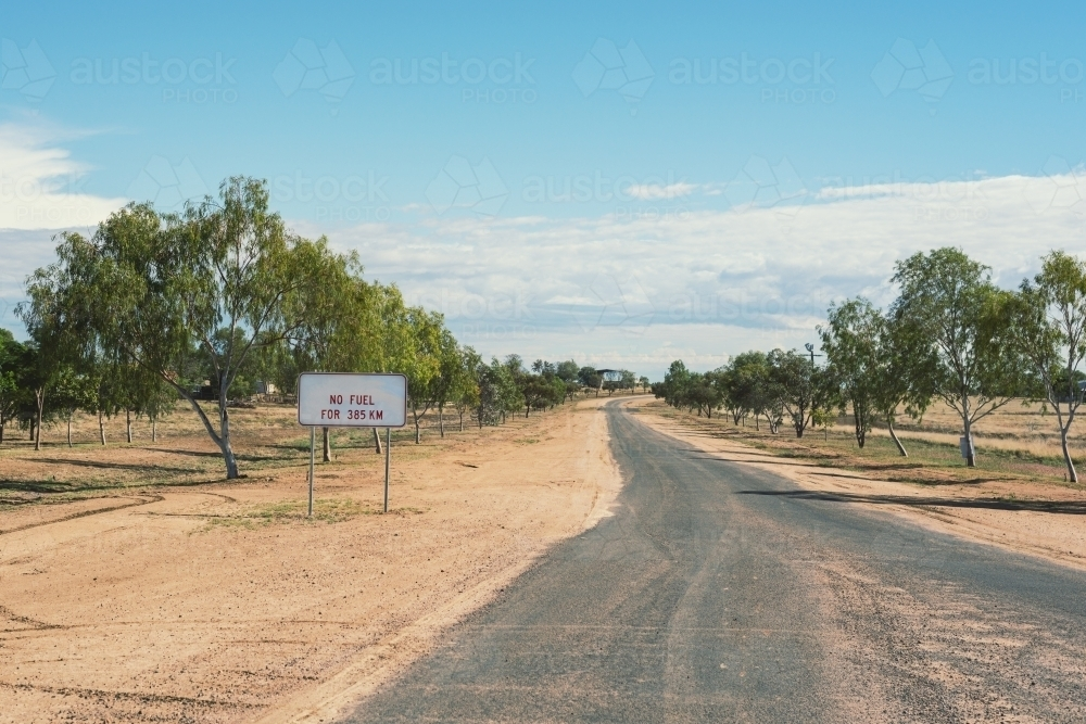Sign warning of limited fuel in outback Northern Territory - Australian Stock Image