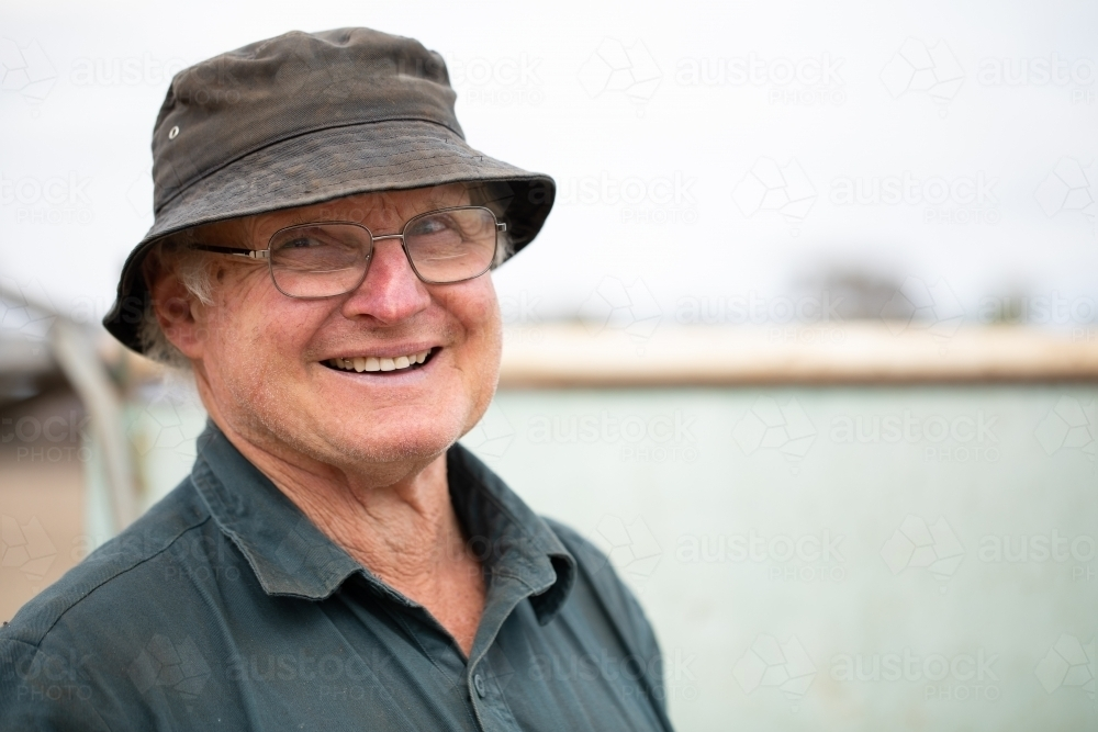 smiling happy short-sighted old bloke - Australian Stock Image