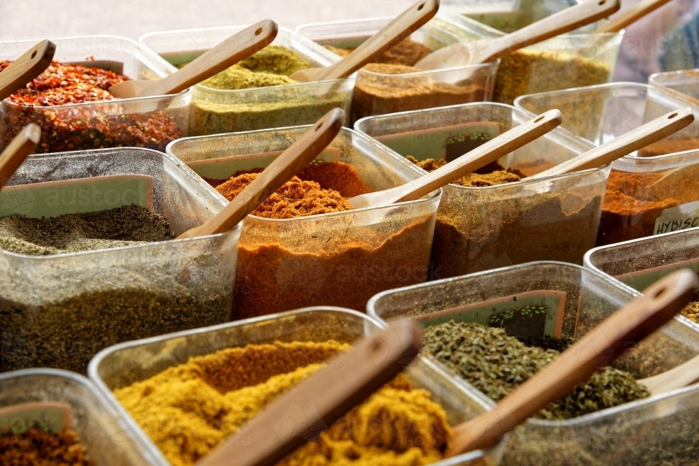 Spices and condiments for sale at Redcliffe Sunday market - Australian Stock Image