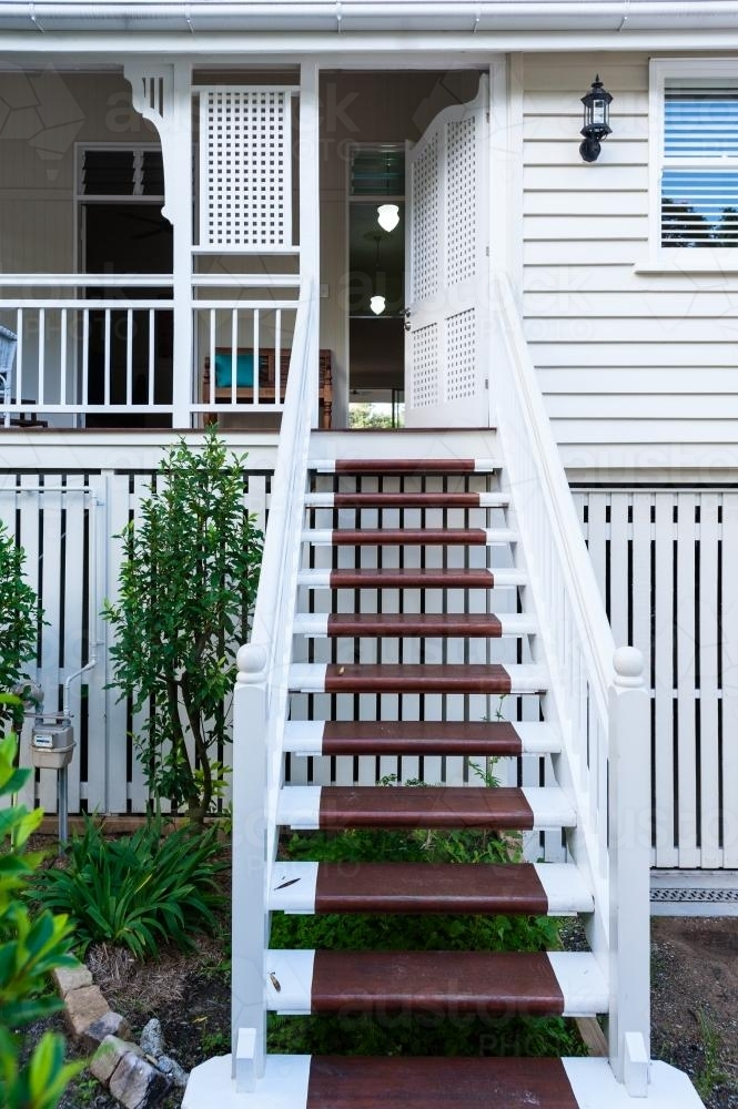 stairs on the front veranda of a Queenslander home - Australian Stock Image