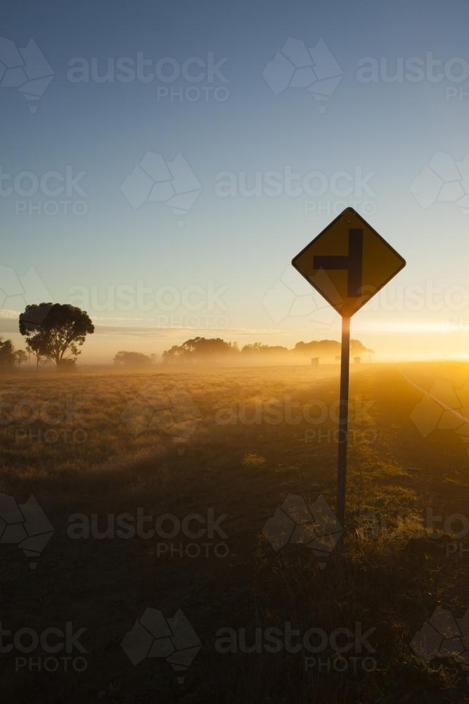 Sunrise in regional highway with Sign in the foreground - Australian Stock Image