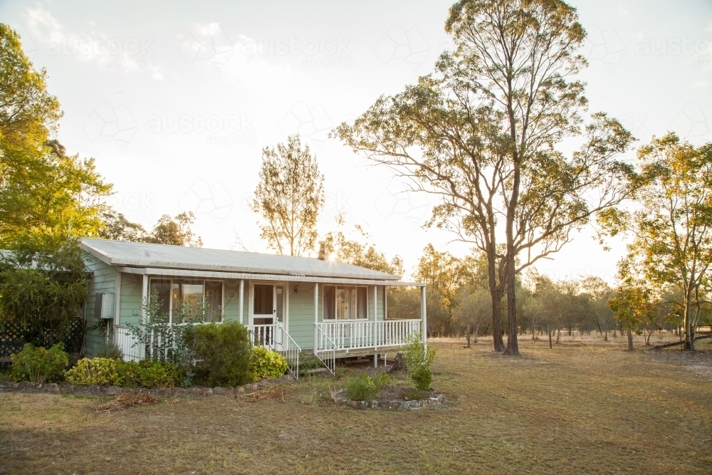 Sunset on a farm over a little cottage - Australian Stock Image