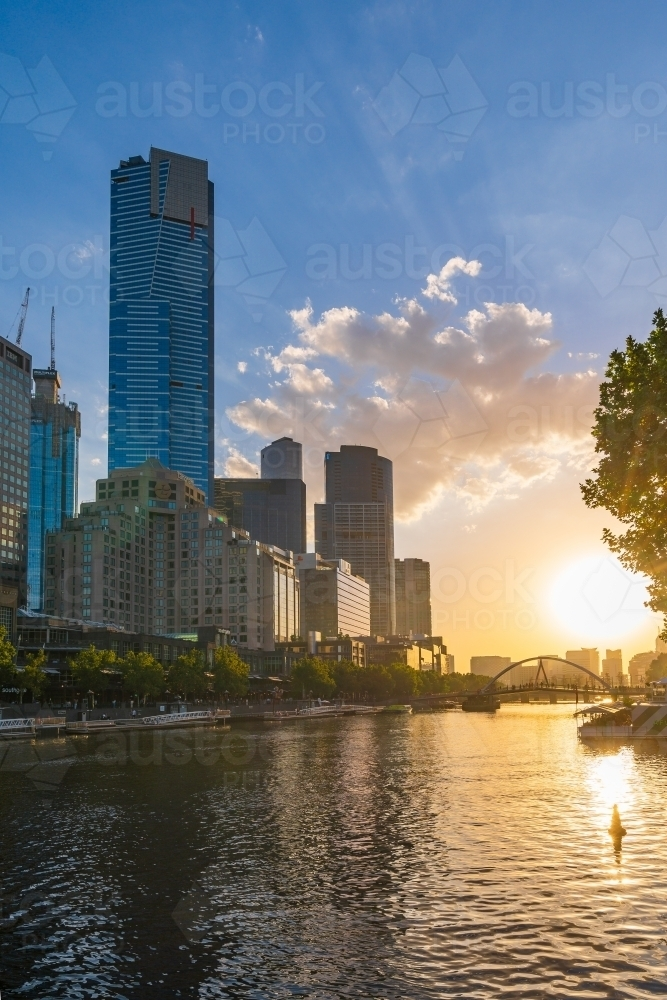 Sunset over an inner city river with high rise buildings along its banks - Australian Stock Image