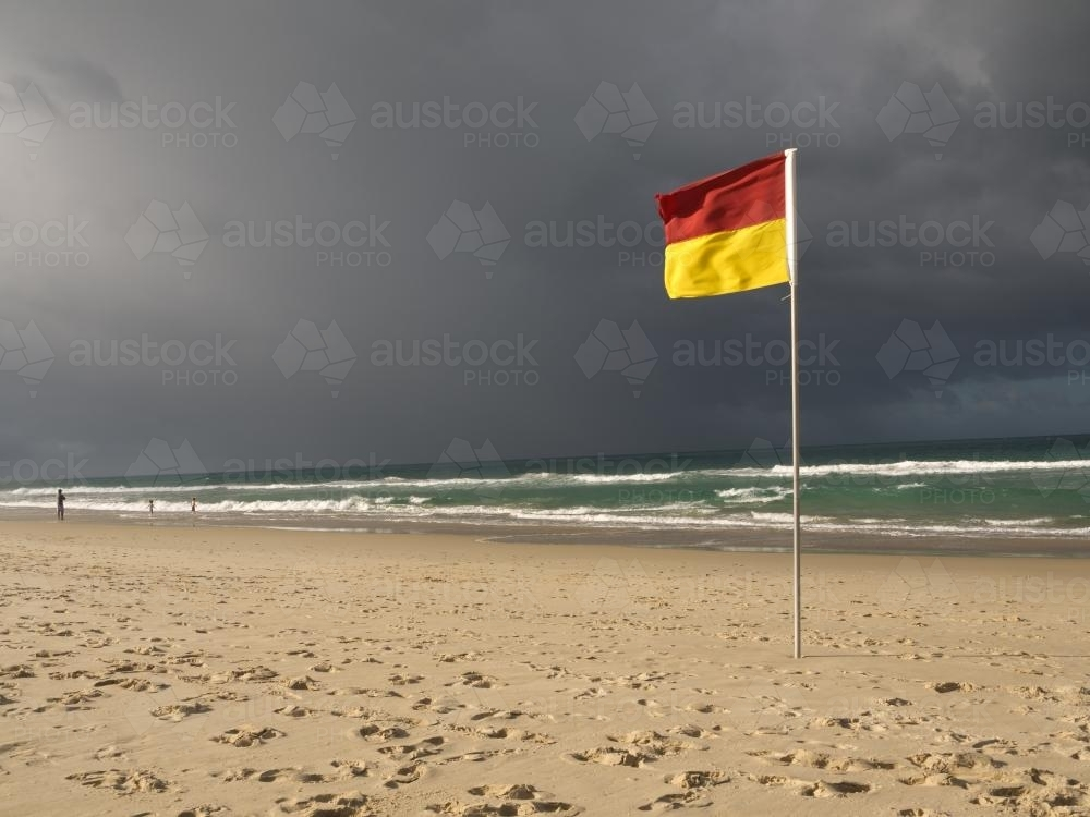 Surf lifesaving flag on a beach - Australian Stock Image