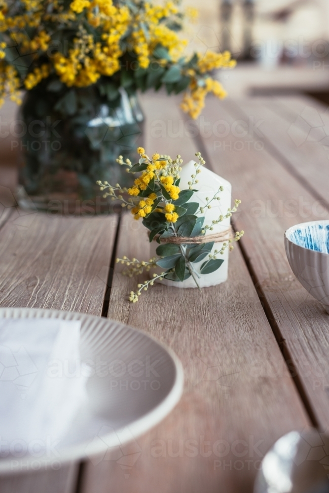 table decor with wattle candle - Australian Stock Image
