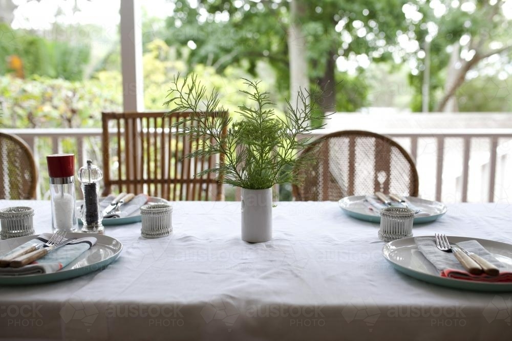 Table setting for lunch on verandah - Australian Stock Image