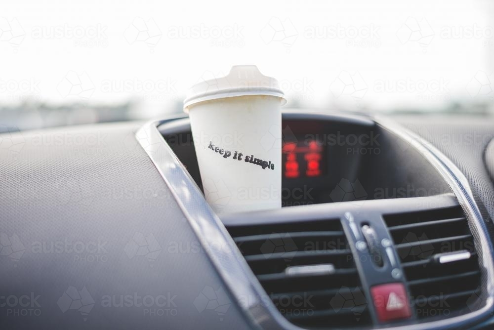 Take away coffee cup in a car - Australian Stock Image