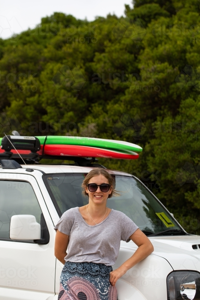 Teen Girl Leaning Against Suv With Surfboards On Roof Rack Australian Stock Image