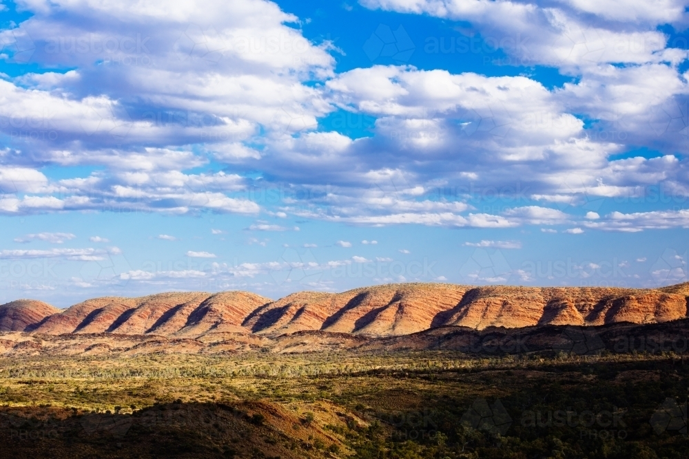 Textured hills and sky of the West MacDonnell Ranges in central Australia. - Australian Stock Image