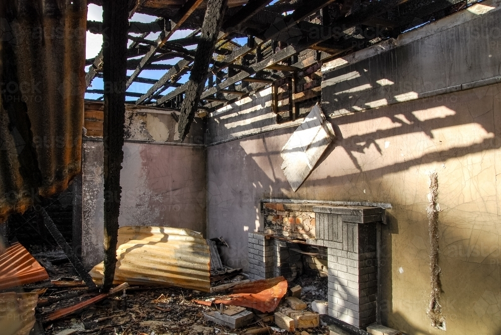 The remains of house fire in regional Victoria - Australian Stock Image