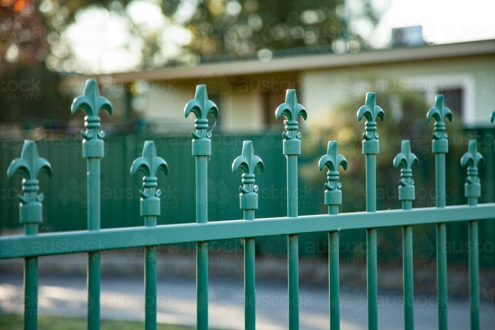 The top of a green school fence - Australian Stock Image