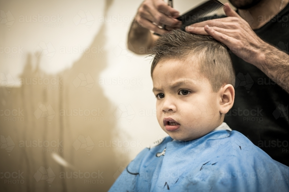 Image Of Three Year Old Mixed Race Boy Having A Haircut Austockphoto