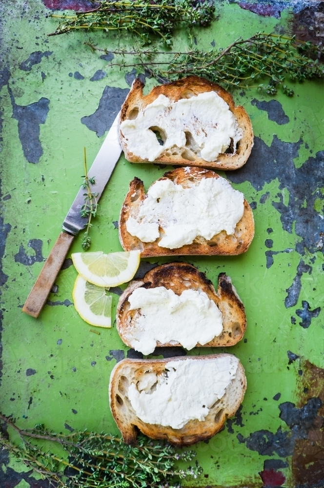 Toast and cheese spread with herbs - Australian Stock Image