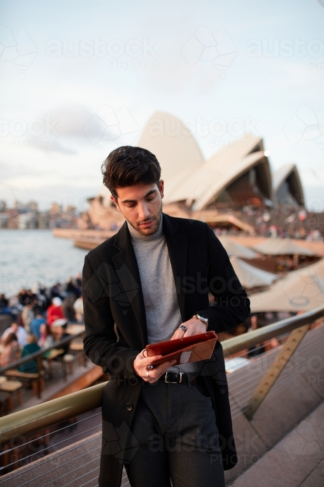 Tourist with the Sydney Opera House in background - Australian Stock Image