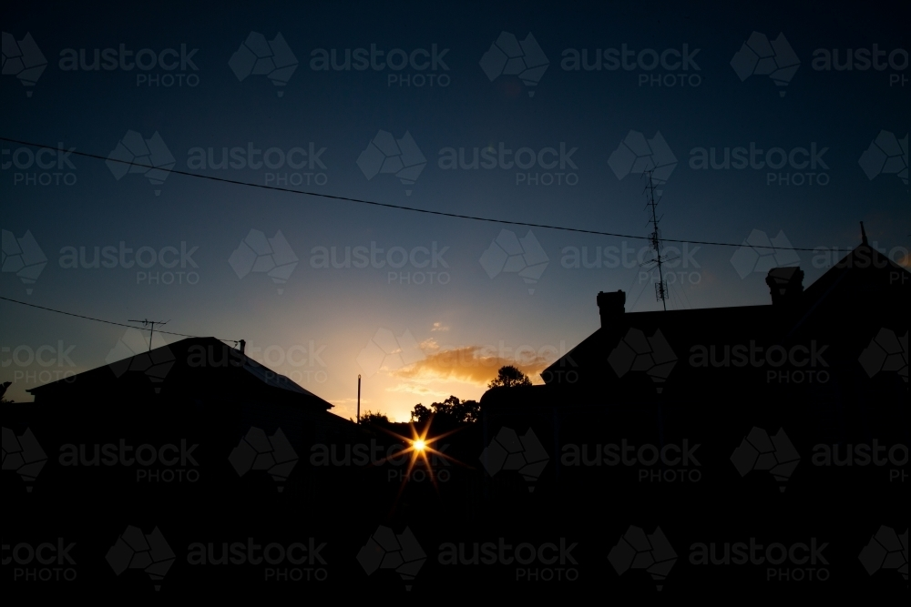 Town house buildings silhouetted against sunset - Australian Stock Image
