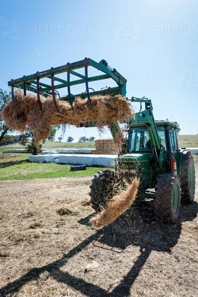 Tractor loading the feeder - Australian Stock Image