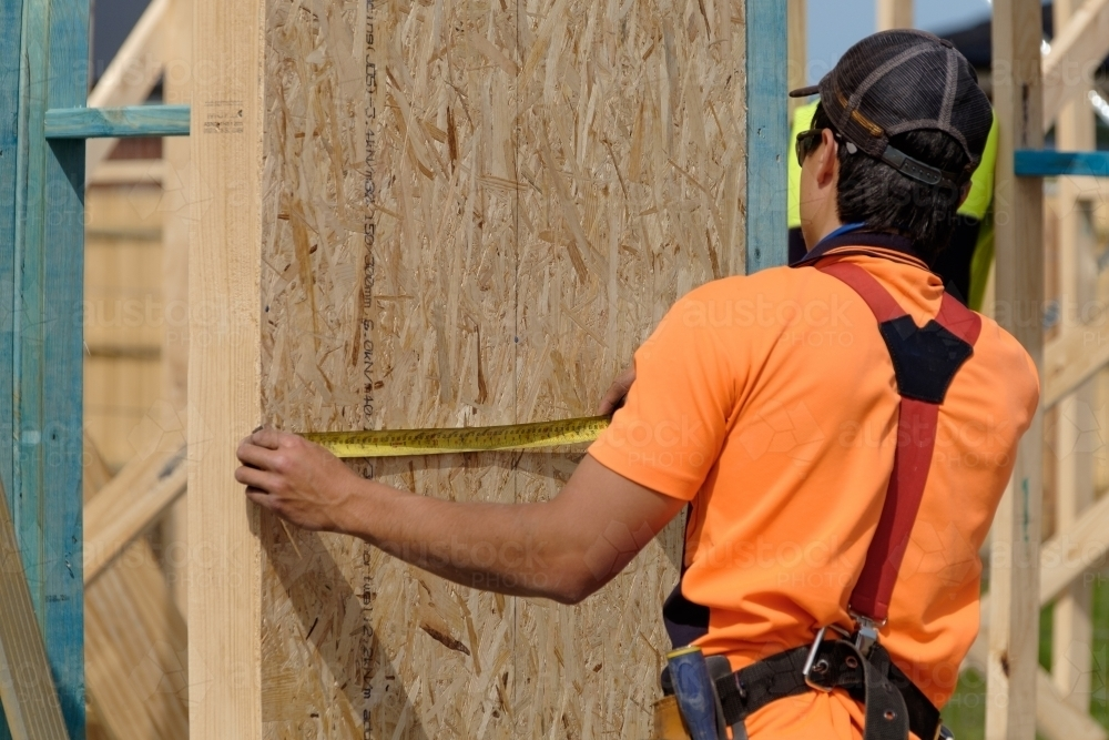 Tradie working on house building site - Australian Stock Image