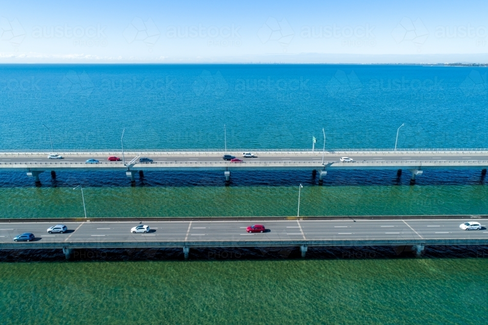 Traffic driving on two bridges over water. - Australian Stock Image