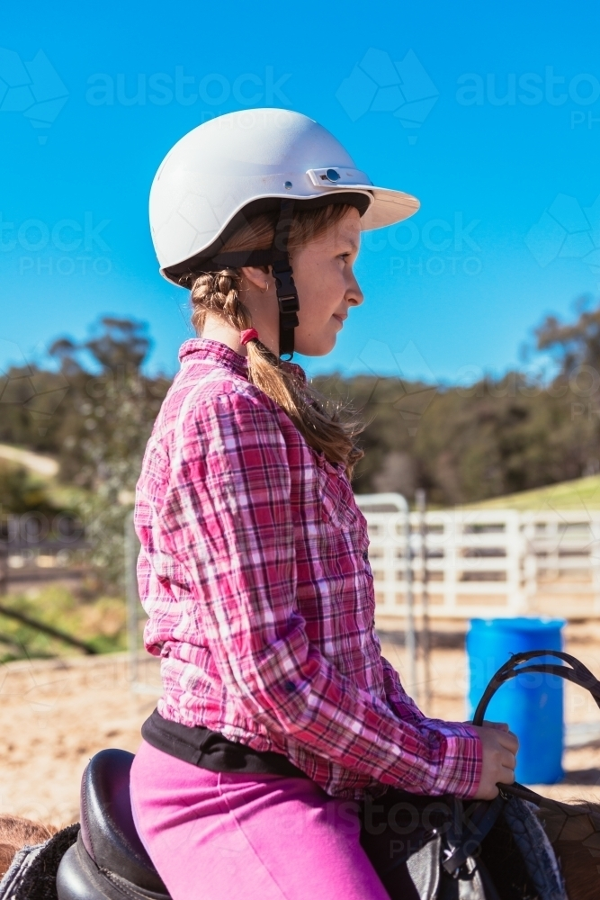 tween girl during a riding lesson - Australian Stock Image
