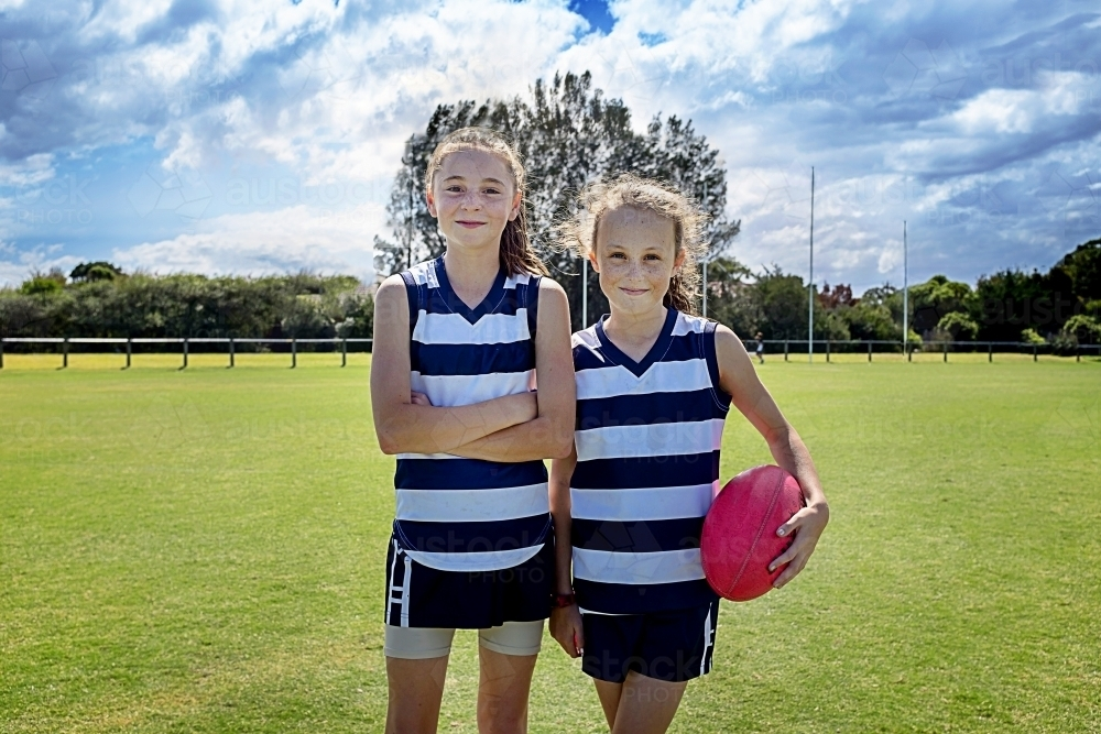 Two girl team players in AFL football - Australian Stock Image