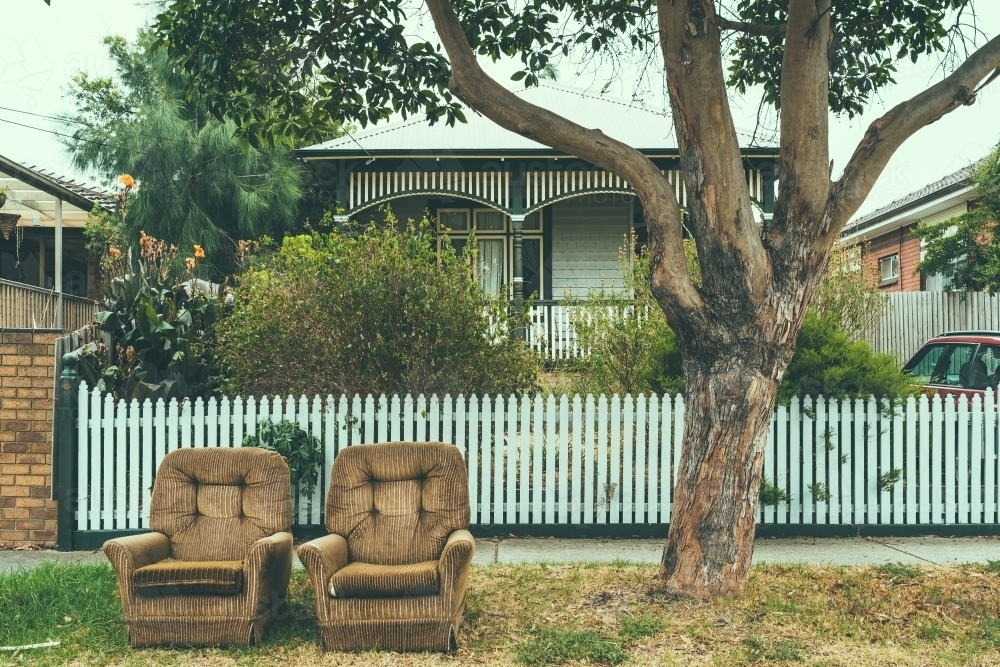 Two old lounge chairs discarded to the verge - Australian Stock Image
