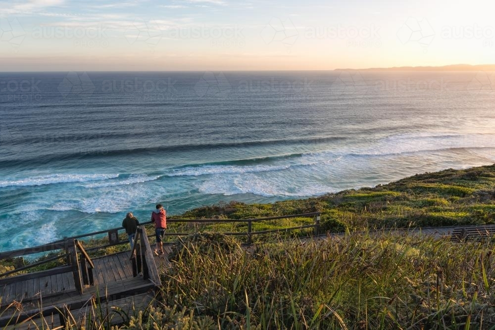 Two people looking out to see from a scenic viewpoint - Australian Stock Image
