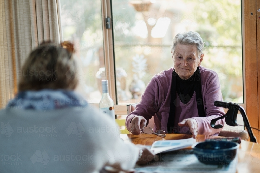 Two Women at a Table - Australian Stock Image