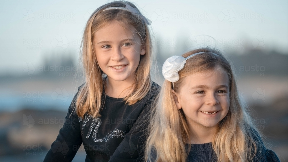Two young girls close up at the beach - Australian Stock Image