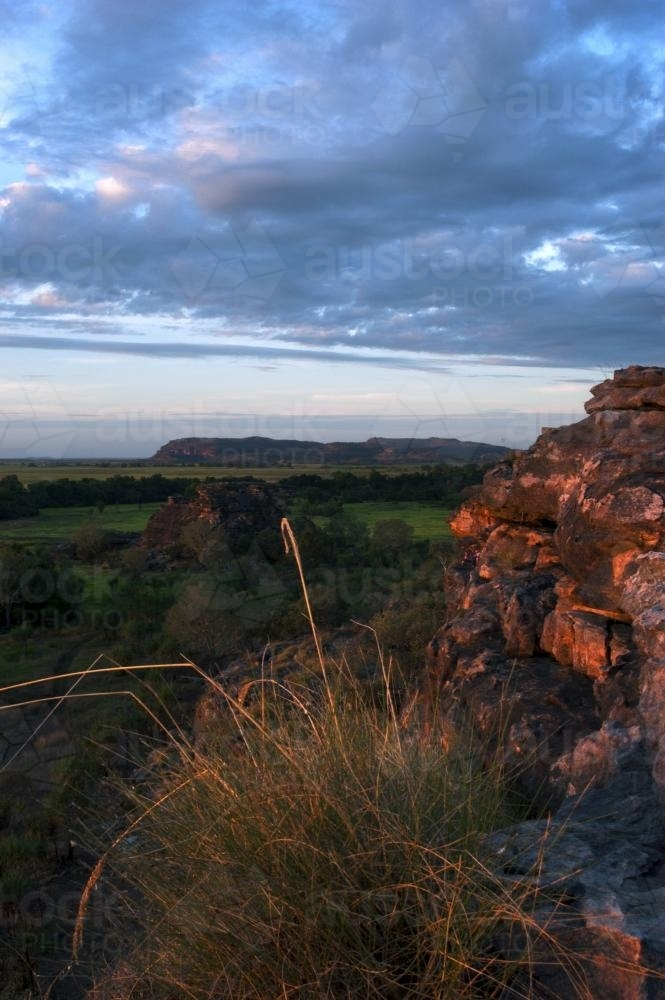 Ubirr Rock Kakadu at sunset with dark clouds - Australian Stock Image