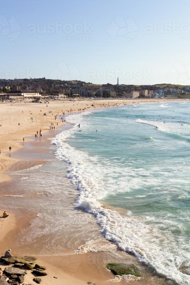 View of Bondi Beach from Bondi Baths on a clear summer day - Australian Stock Image