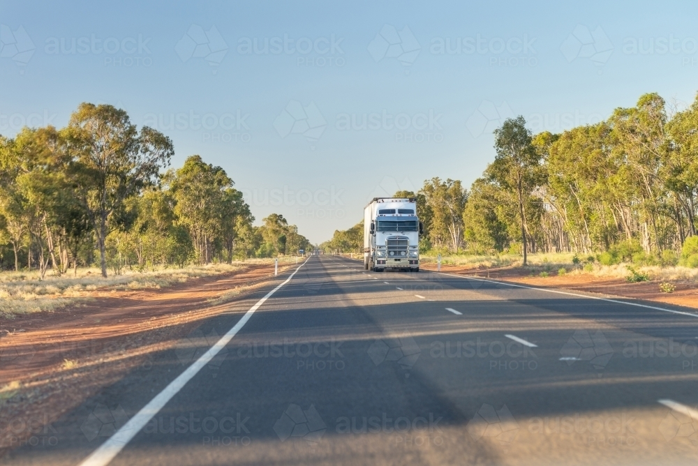View of truck on road from passenger seat - Australian Stock Image
