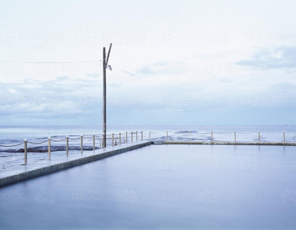 View out to sea over calm ocean pool - Australian Stock Image