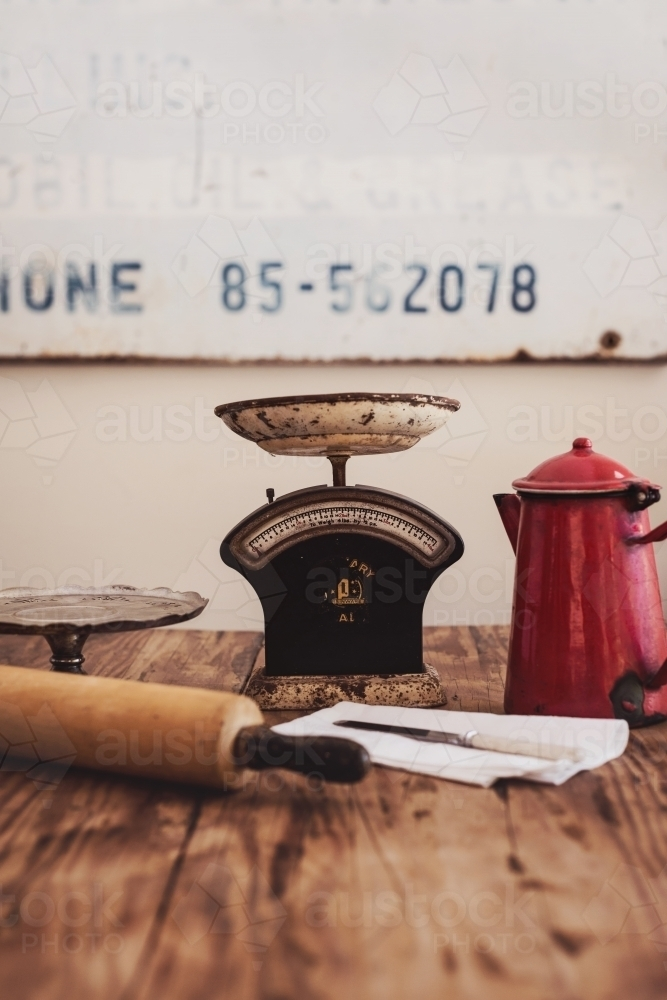 vintage kitchen items on a wooden table - Australian Stock Image