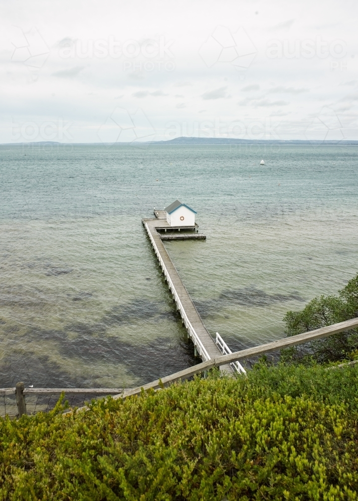 Walkway leading to private jetty and boat shed - Australian Stock Image