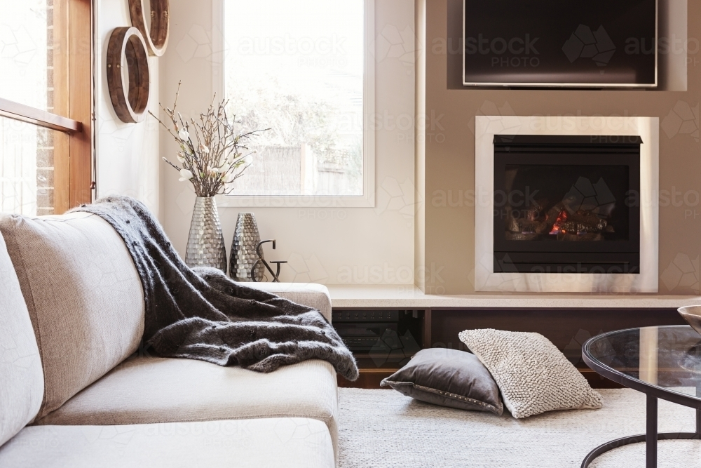 Warm inviting interior with gas log fireplace  - Australian Stock Image