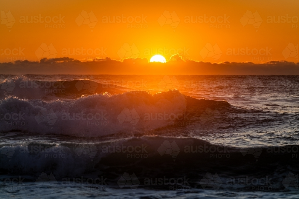 waves and beach at sunrise - Australian Stock Image