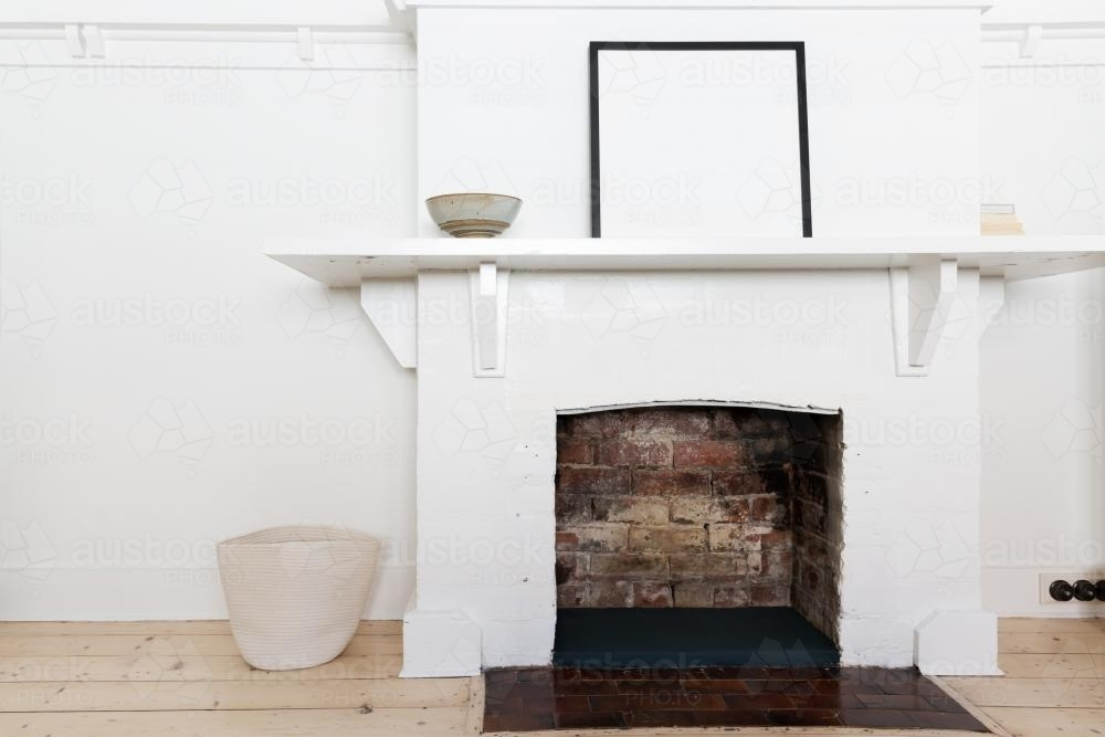 White brick fire place in vintage styled living room interior - Australian Stock Image